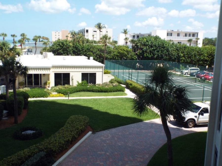 view of clubhouse and tennis courts